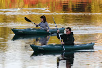 This is a photo of two people kyaking at Ravine Lake