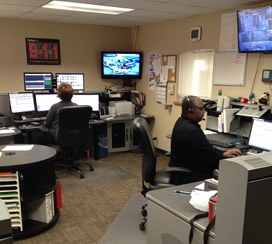 This is a photo of two dispatchers in the Dispatch Center