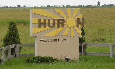 This is a photo of the Huron welcomes you sign